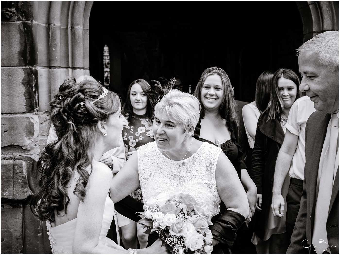 Guest greeting bride: Bank House Wedding Photographer Clive Blair Photography. Documentary Birmingham Wedding Photographer