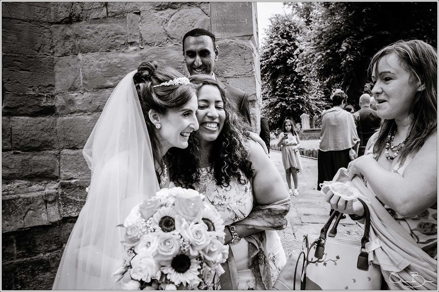 Bride being greeted by happy woman: Bank House Wedding Photographer Clive Blair Photography. Documentary Birmingham Wedding Photographer