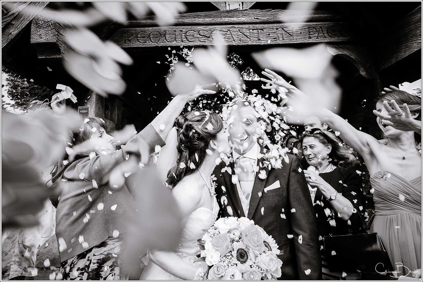 Bride and groom with confetti: Bank House Wedding Photographer Clive Blair Photography. Documentary Birmingham Wedding Photographer