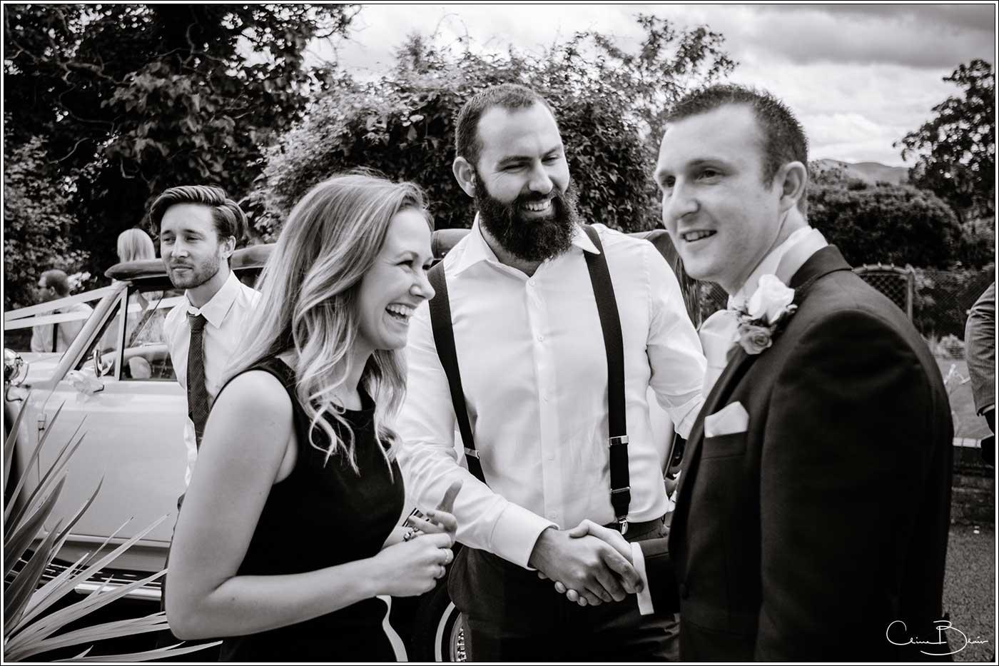 Man and woman greeting groom: Bank House Wedding Photographer Clive Blair Photography. Documentary Birmingham Wedding Photographer