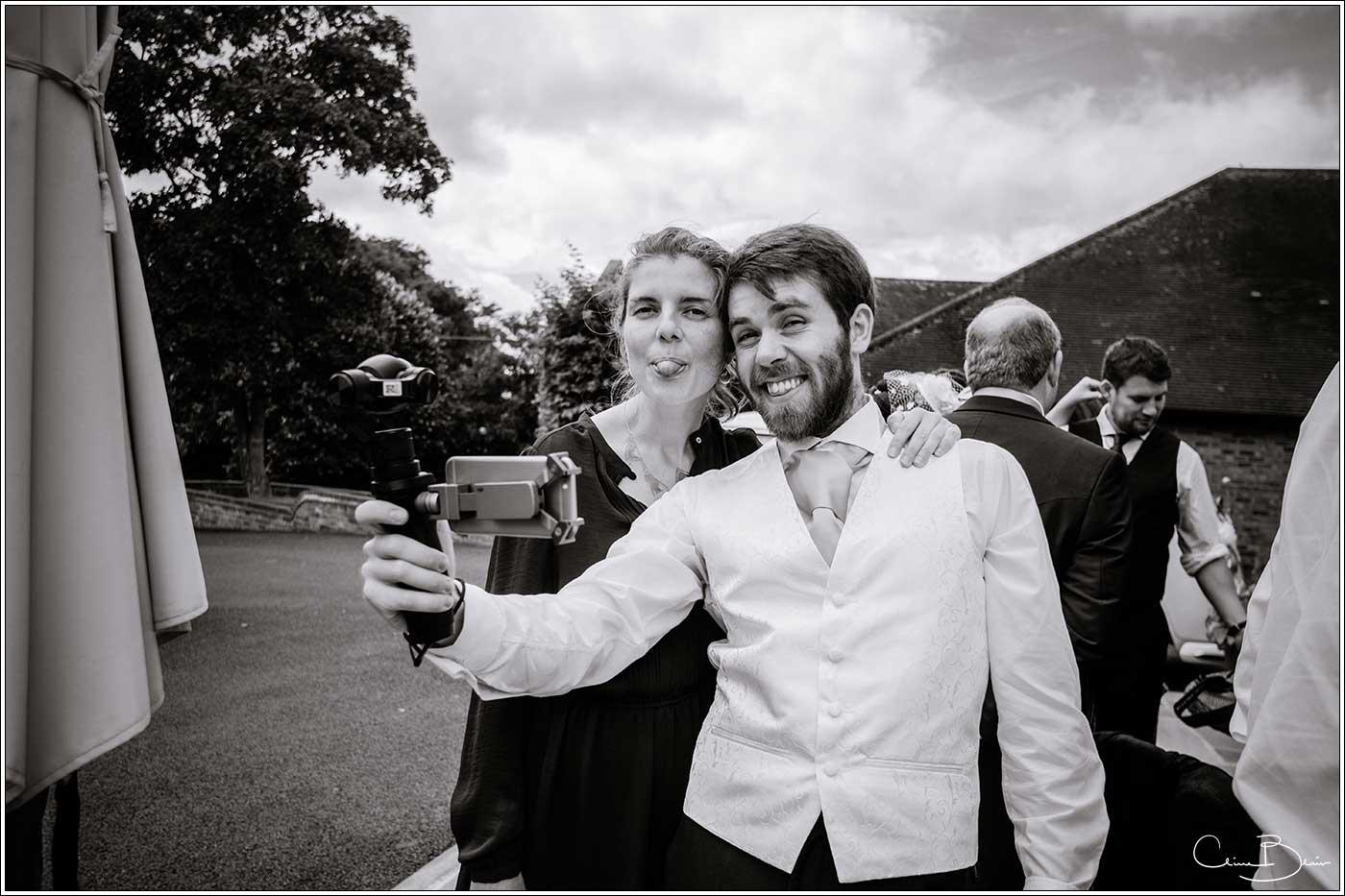 Man and woman taking selfie: Bank House Wedding Photographer Clive Blair Photography. Documentary Birmingham Wedding Photographer