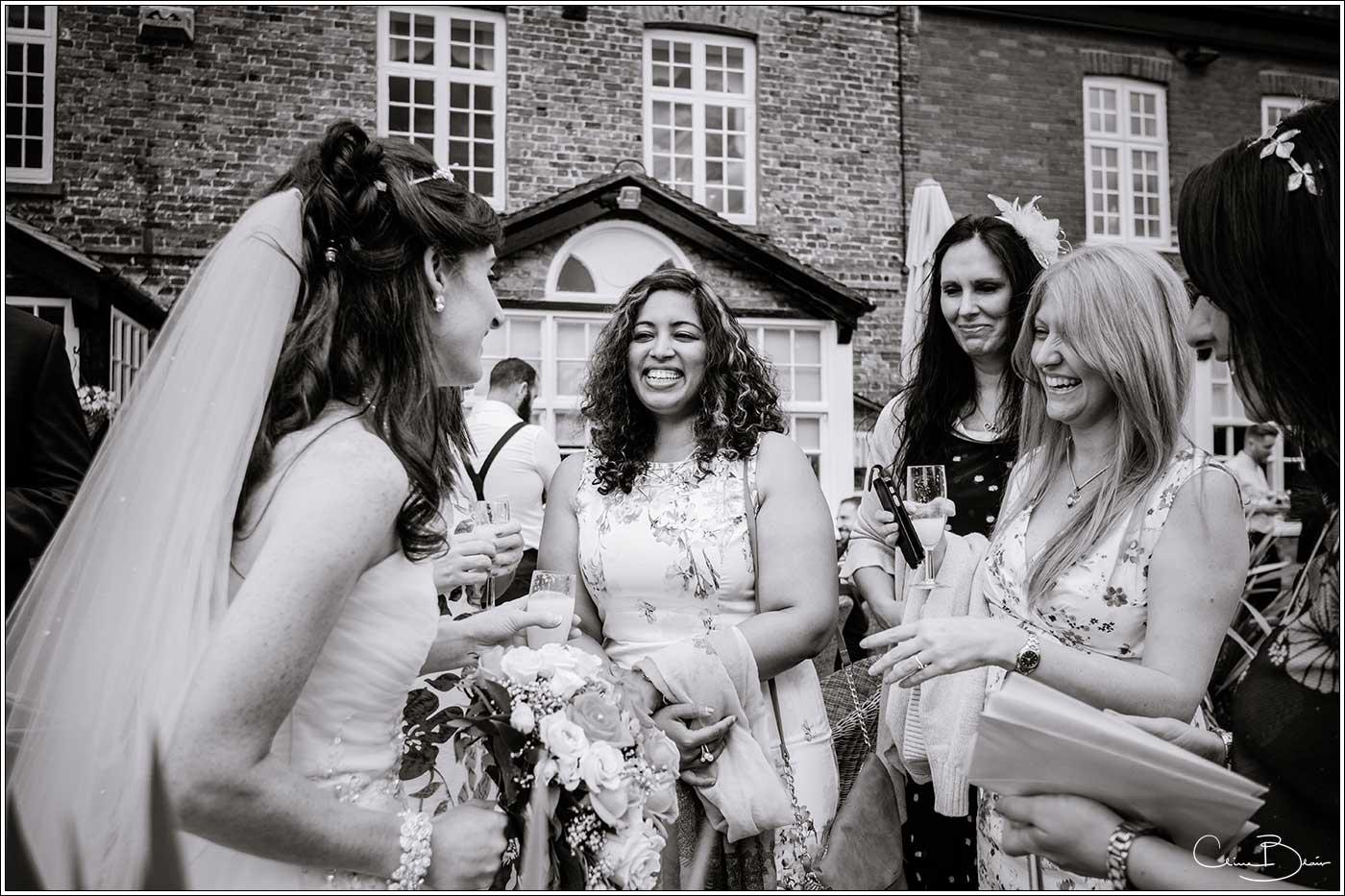 Women greeting happy bride: Bank House Wedding Photographer Clive Blair Photography. Documentary Birmingham Wedding Photographer