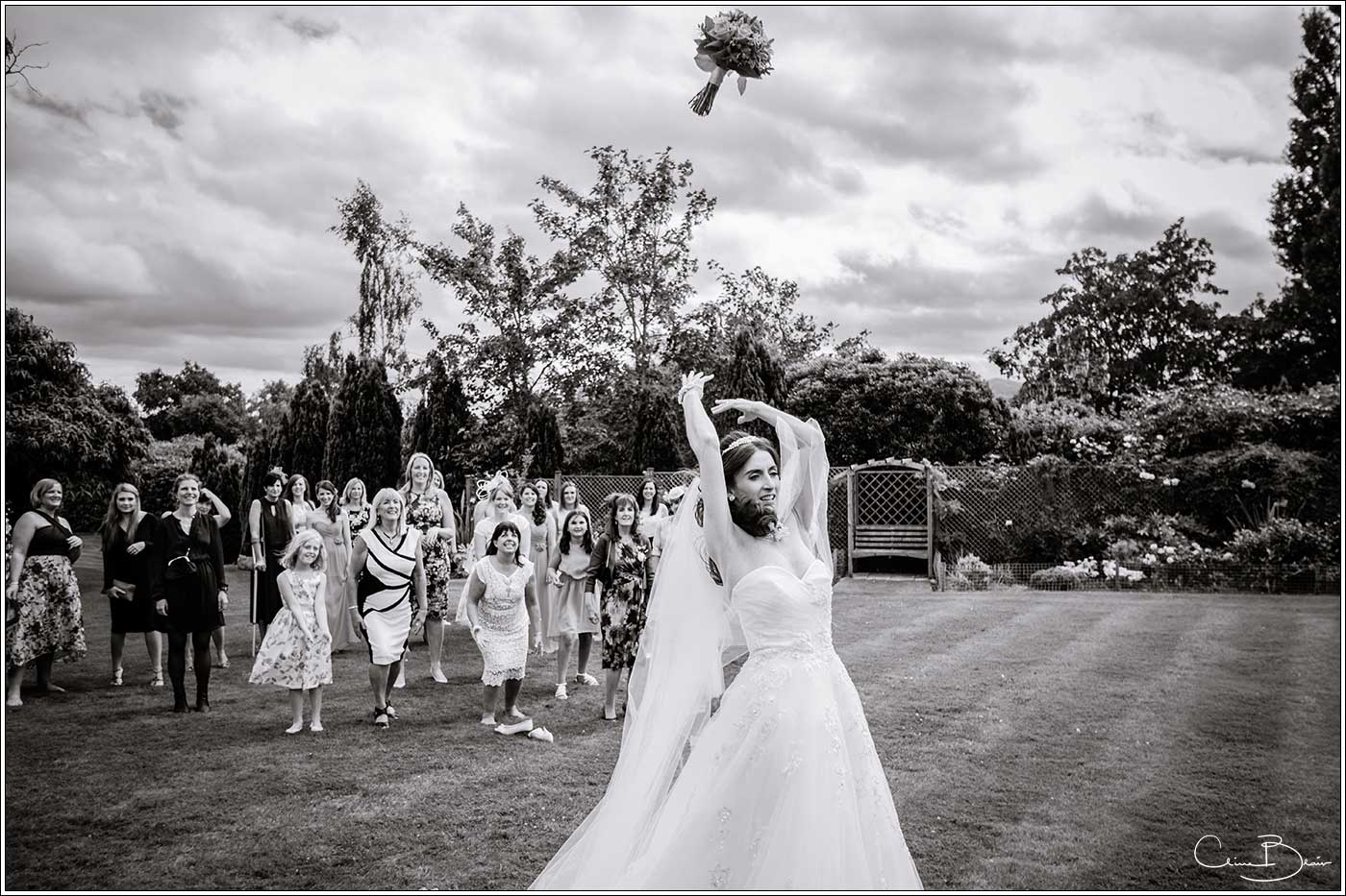 Bride throwing her bouquet: Bank House Wedding Photographer Clive Blair Photography. Documentary Birmingham Wedding Photographer