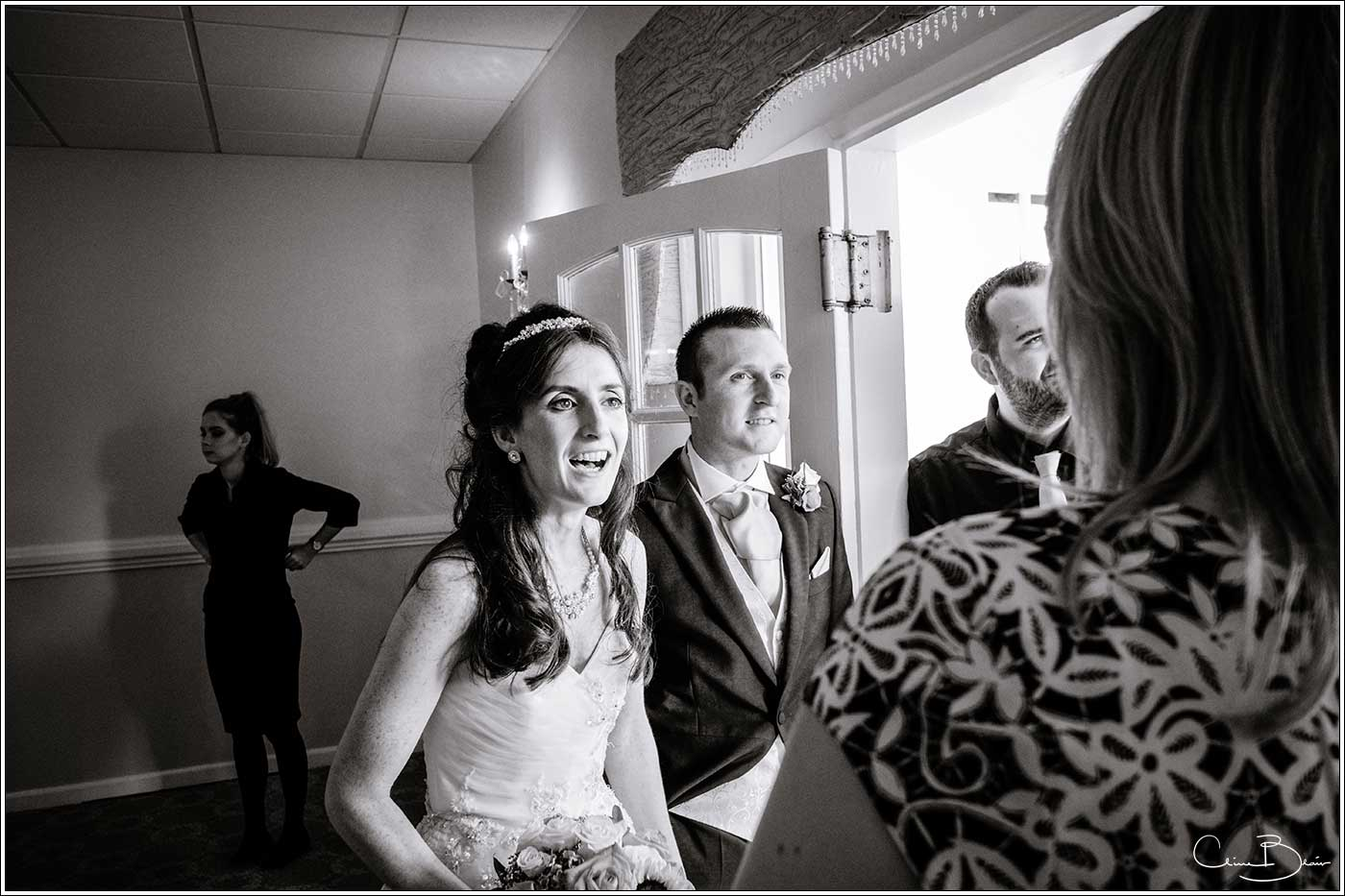 Bride and groom greeting guests: Bank House Wedding Photographer Clive Blair Photography. Documentary Birmingham Wedding Photographer
