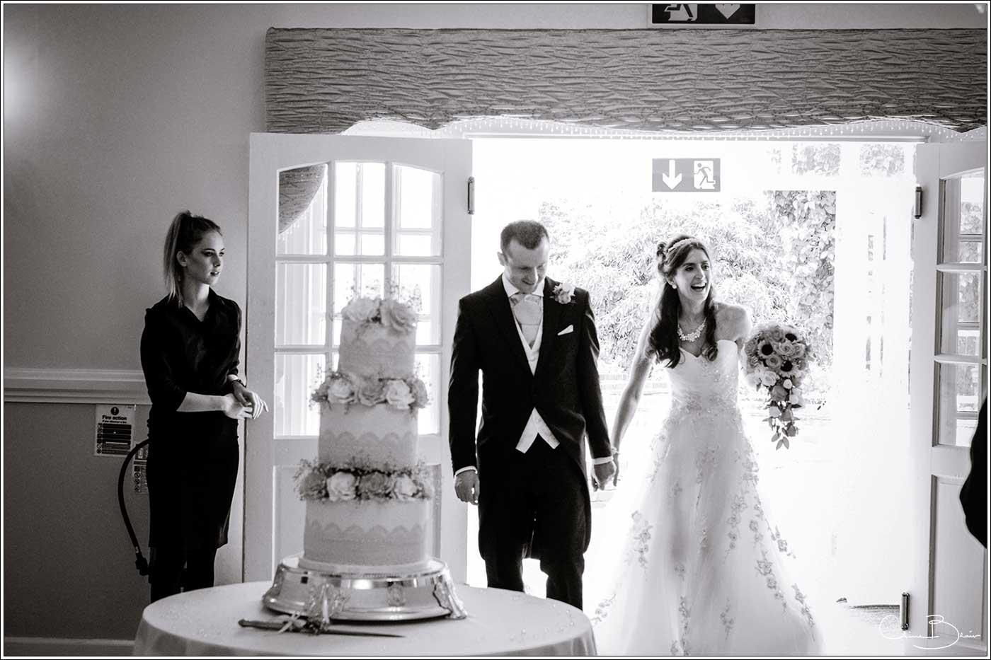 bride and groom enetering wedding breakfast: Bank House Wedding Photographer Clive Blair Photography. Documentary Birmingham Wedding Photographer