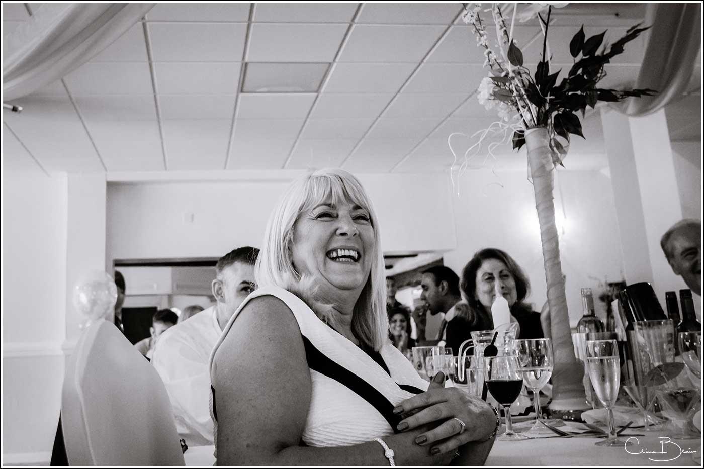Smiling woman at wedding breakfast: Bank House Wedding Photographer Clive Blair Photography. Documentary Birmingham Wedding Photographer