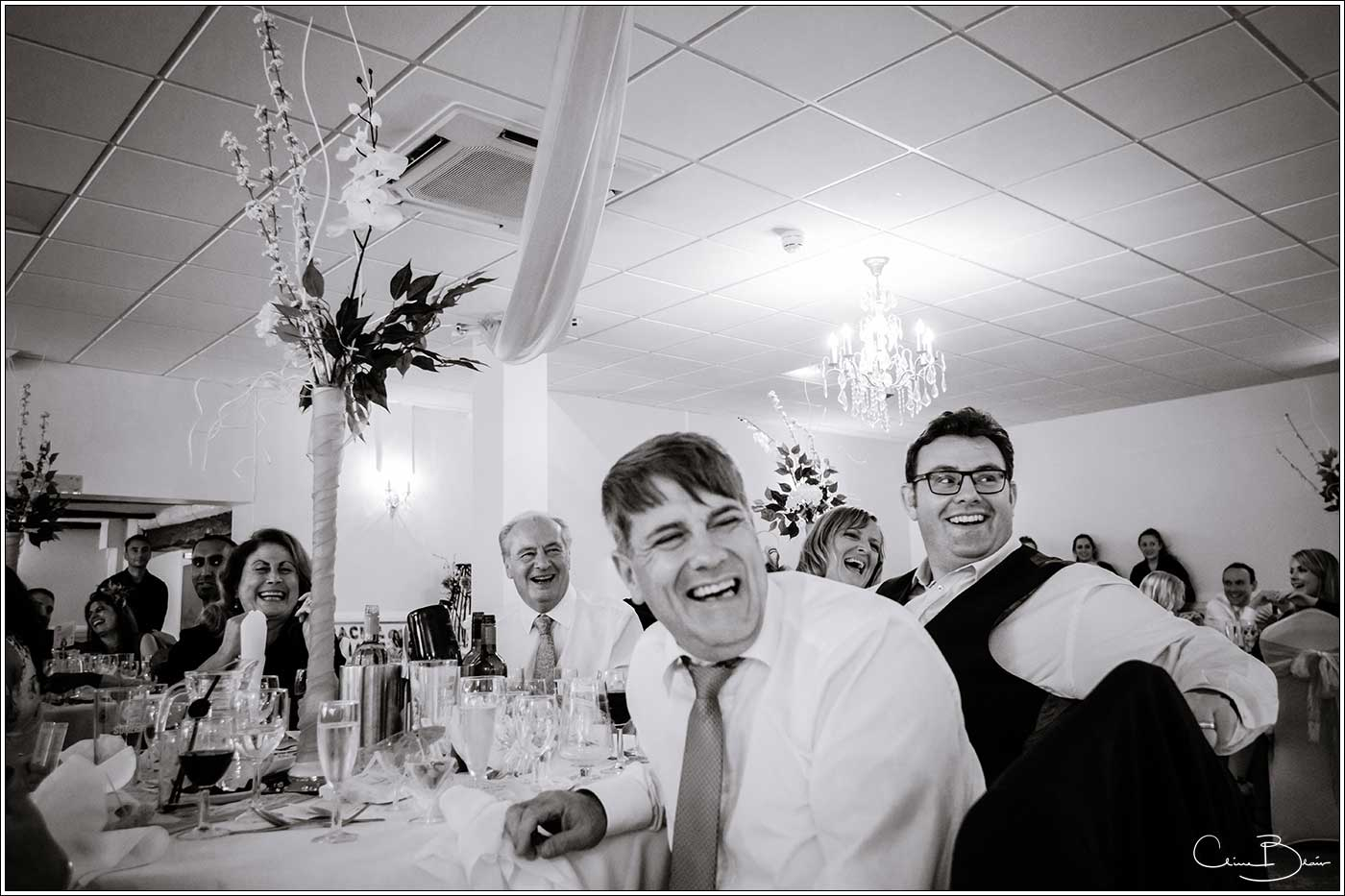 Laughing guests at wedding breakfast: Bank House Wedding Photographer Clive Blair Photography. Documentary Birmingham Wedding Photographer