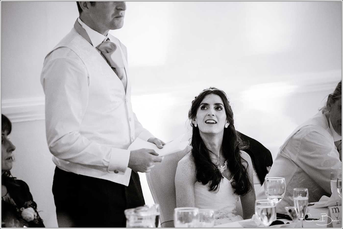 Bride listening to her groom giving speech: Bank House Wedding Photographer Clive Blair Photography. Documentary Birmingham Wedding Photographer