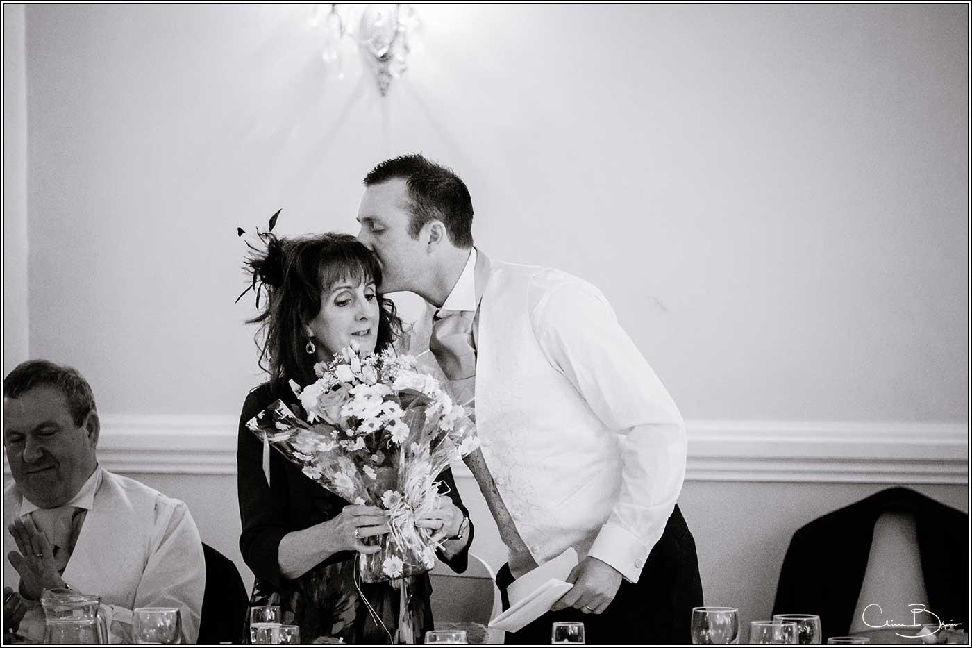 Groom kissing his mother: Bank House Wedding Photographer Clive Blair Photography. Documentary Birmingham Wedding Photographer