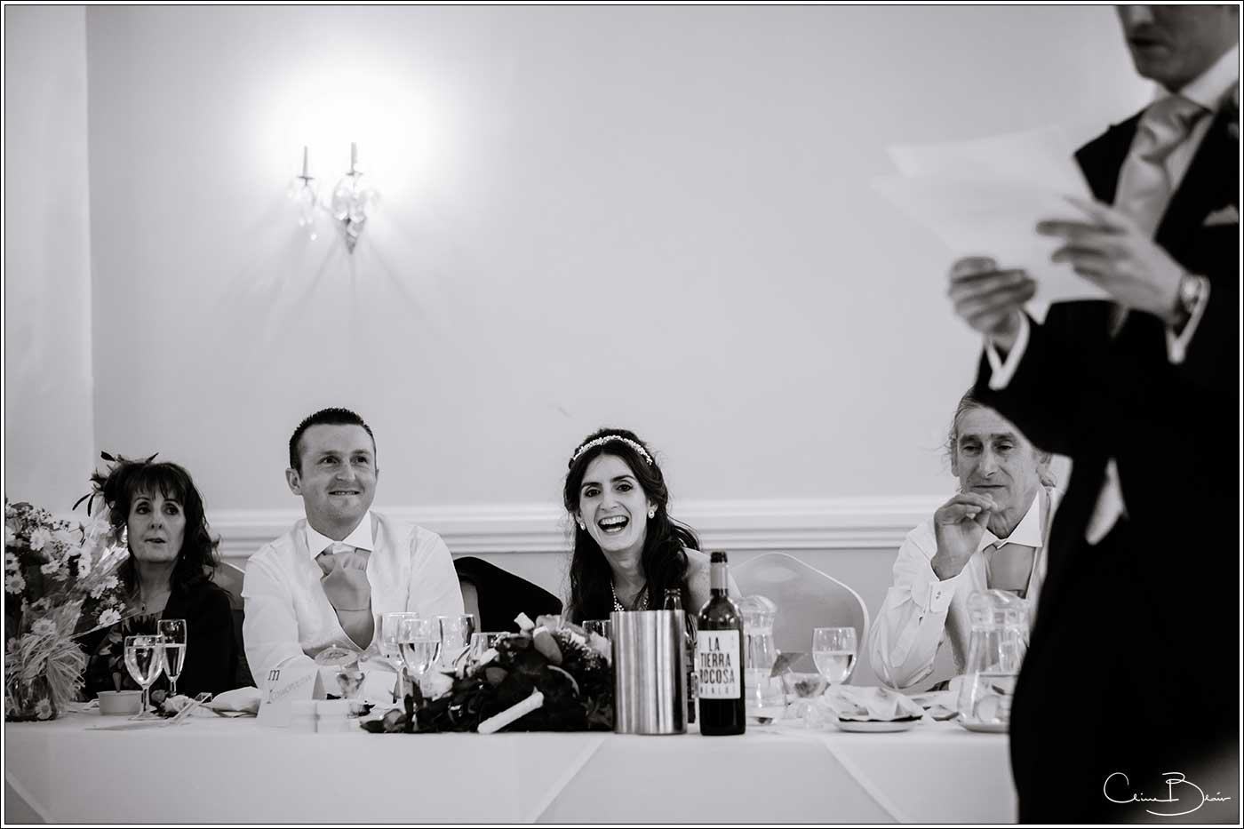 Bride and groom during speeches: Bank House Wedding Photographer Clive Blair Photography. Documentary Birmingham Wedding Photographer