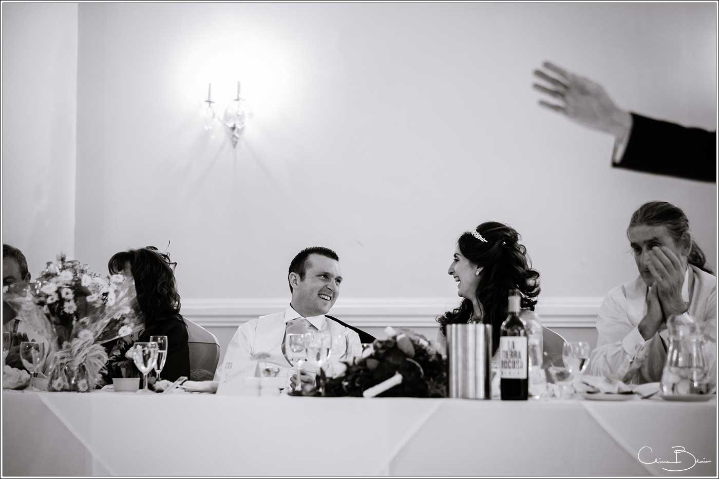Bride and groom listening to speeches: Bank House Wedding Photographer Clive Blair Photography. Documentary Birmingham Wedding Photographer