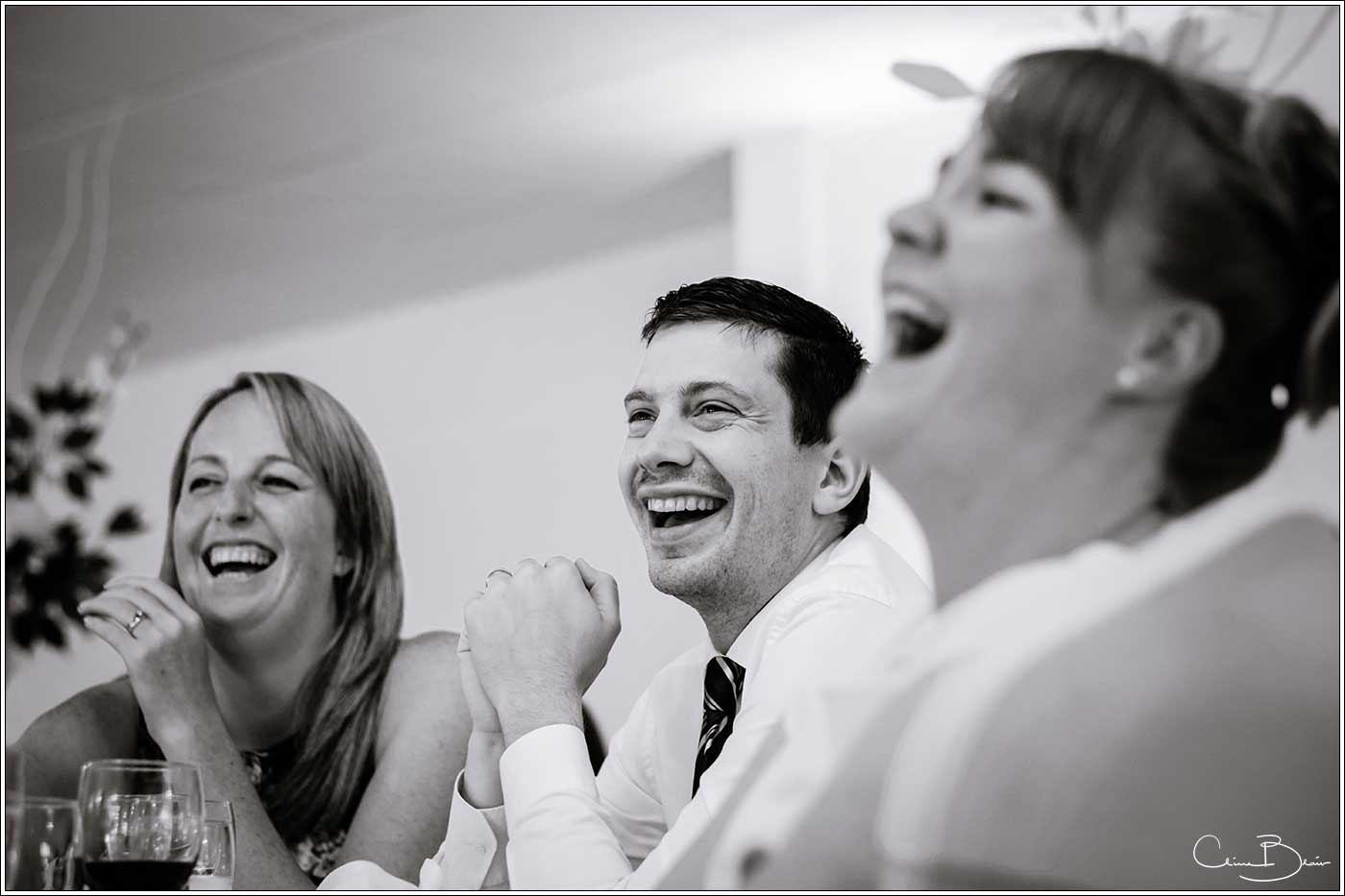 Wedding guests laughing during the speeches: Bank House Wedding Photographer Clive Blair Photography. Documentary Birmingham Wedding Photographer
