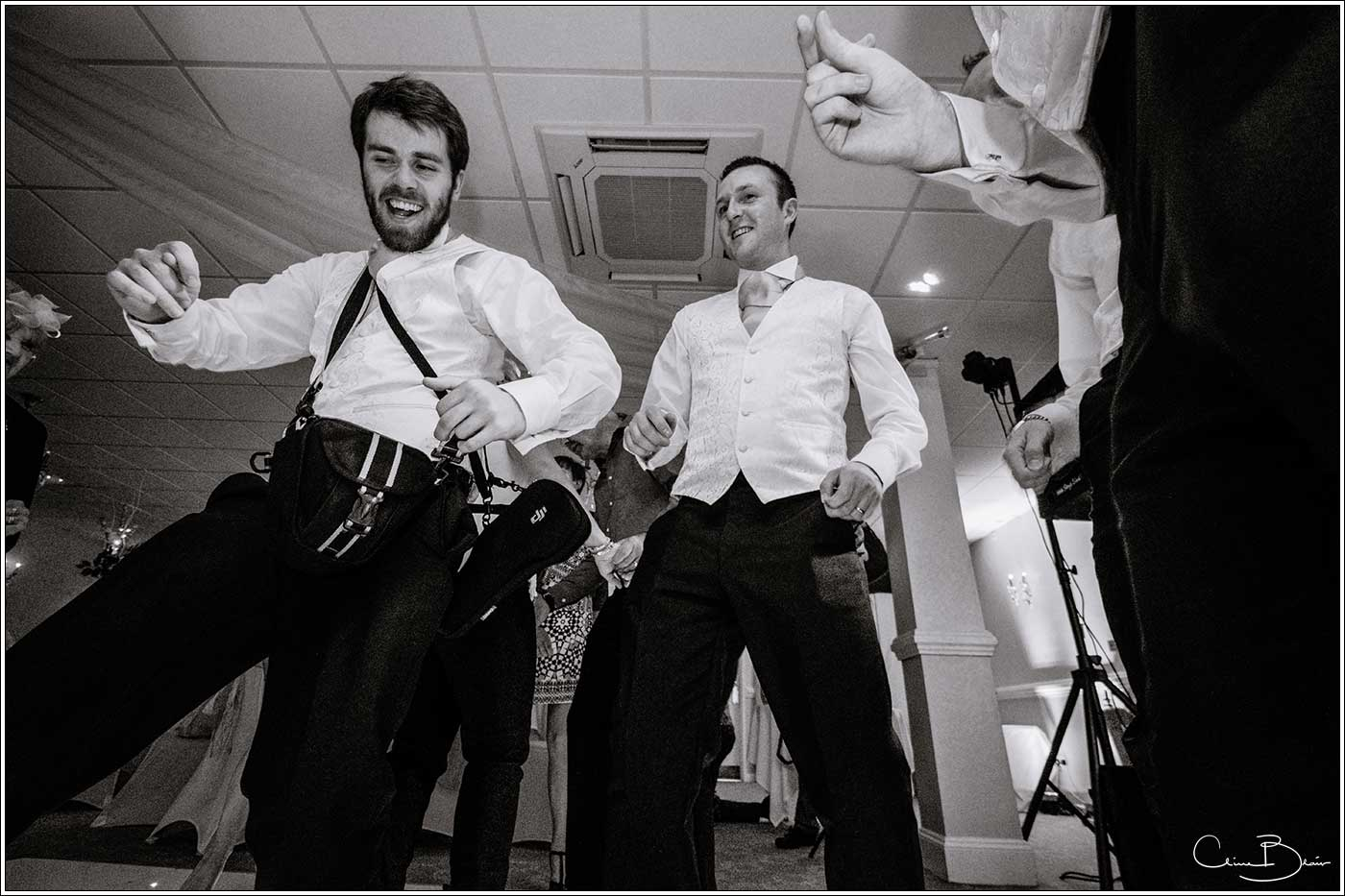 Groom with guest on dancefloor: Bank House Wedding Photographer Clive Blair Photography. Documentary Birmingham Wedding Photographer