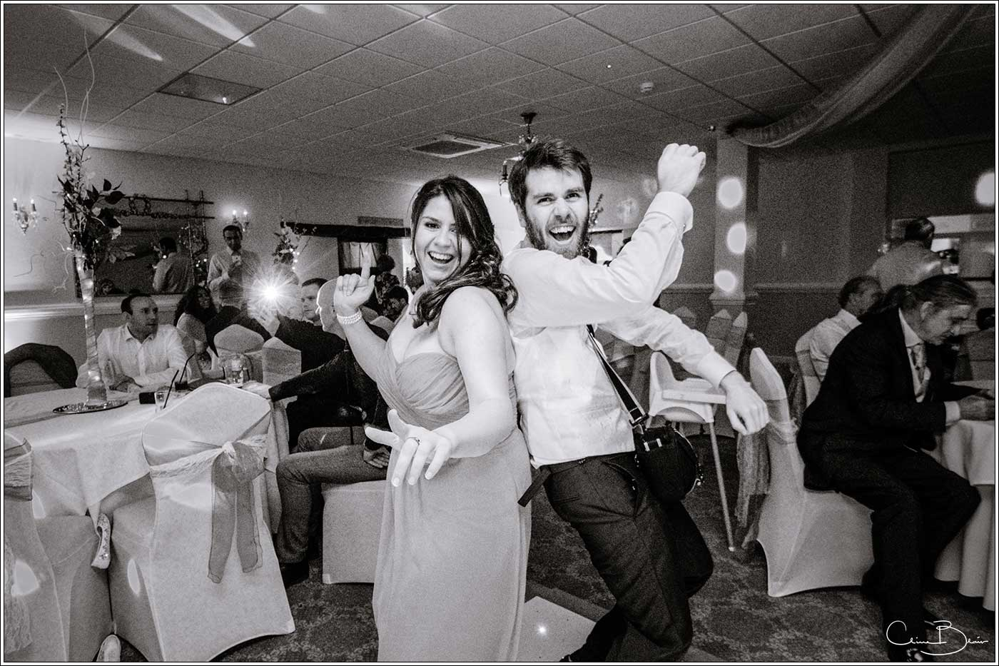 2 happy guests on dancefloor