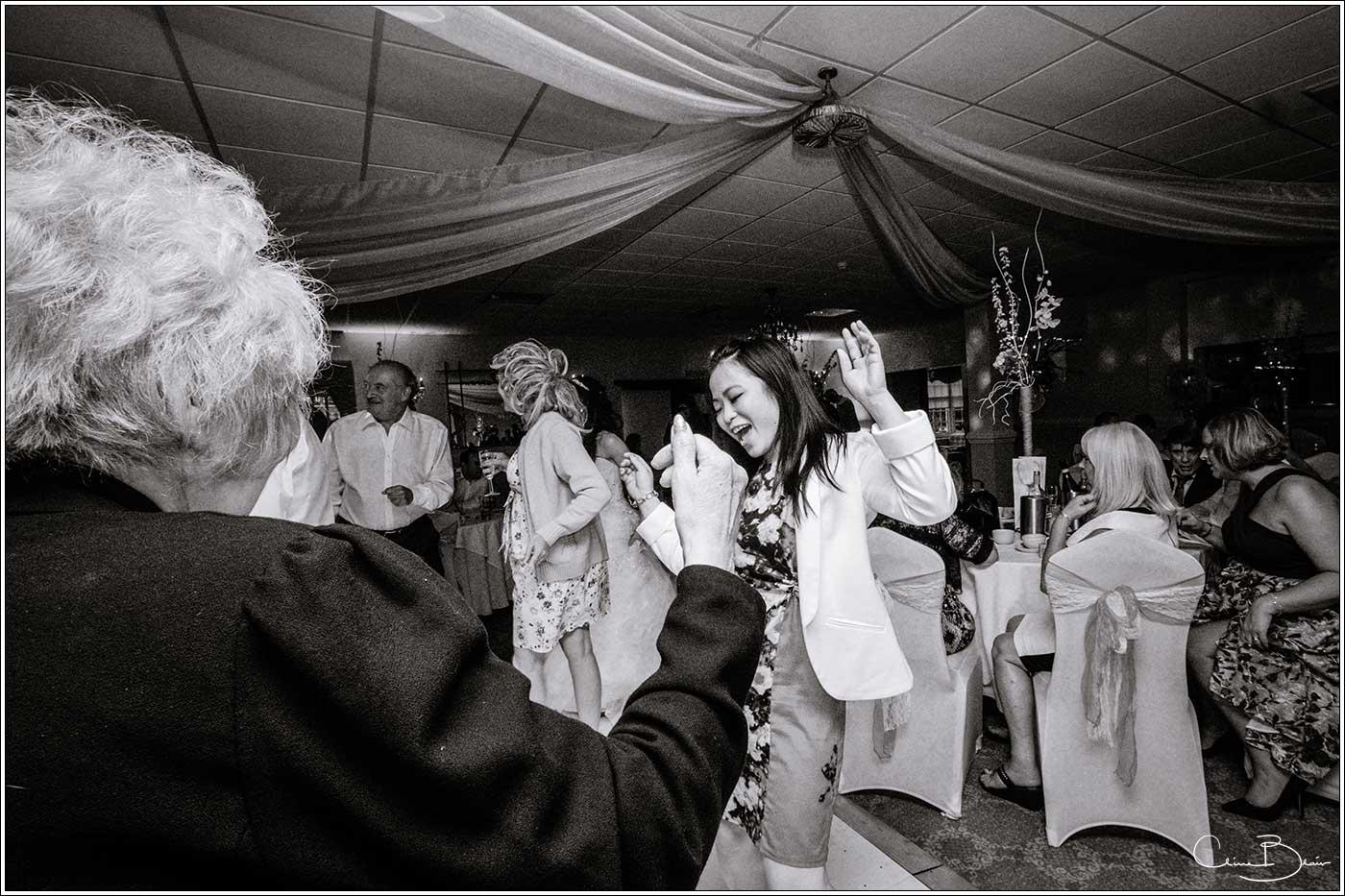 Woman guests dancing: Bank House Wedding Photographer Clive Blair Photography. Documentary Birmingham Wedding Photographer