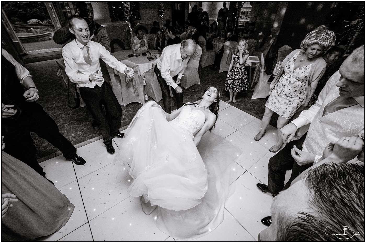 Bride doing limbo dance: Bank House Wedding Photographer Clive Blair Photography. Documentary Birmingham Wedding Photographer