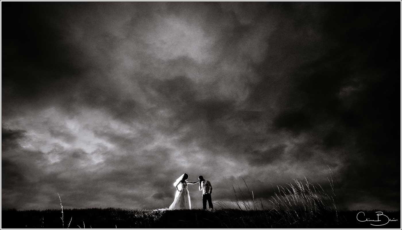 Backlit bride and groom on hill: Bank House Wedding Photographer Clive Blair Photography. Documentary Birmingham Wedding Photographer