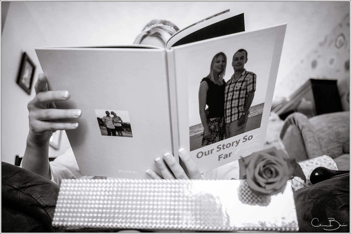 Bride reading book sent by her fiance before the wedding-by Hampton manor wedding photographer Clive Blair Photography