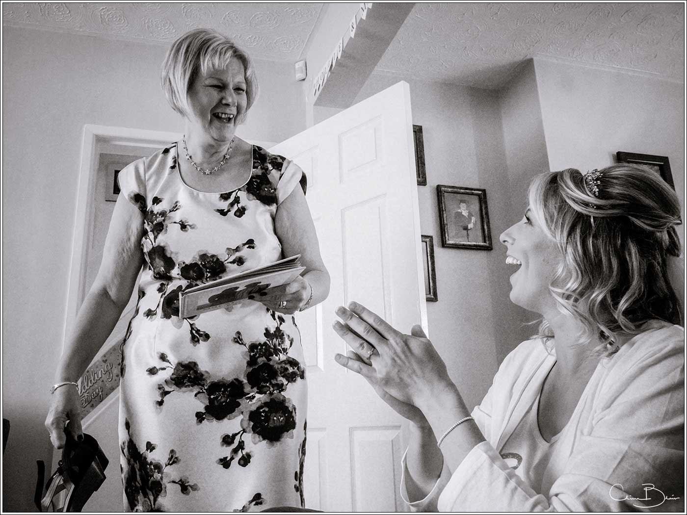 Bride with mother-by Hampton manor wedding photographer Clive Blair Photography