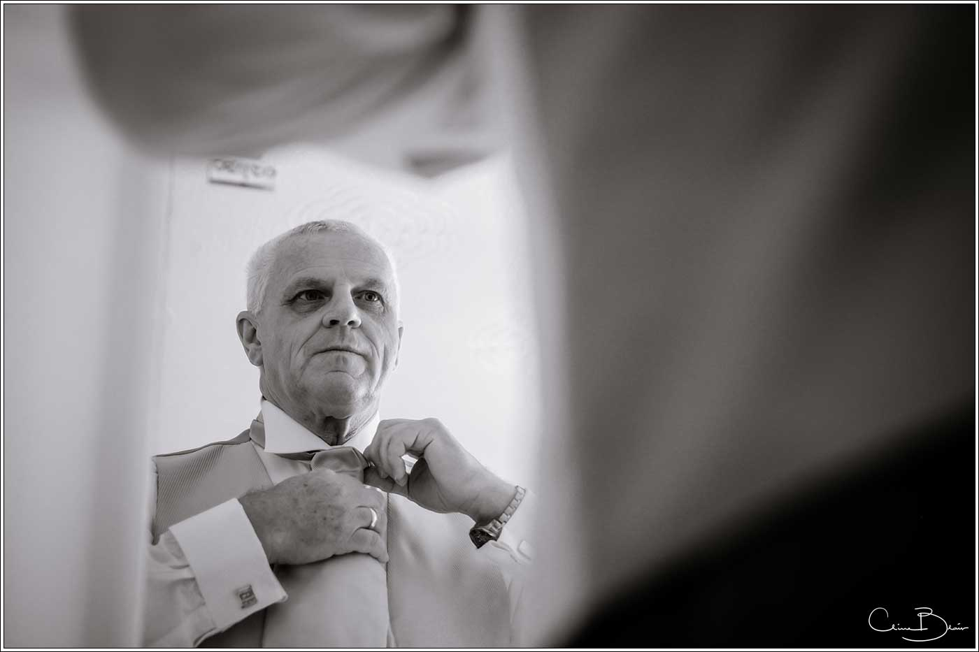 Father of bride getting ready-by Hampton manor wedding photographer Clive Blair Photography