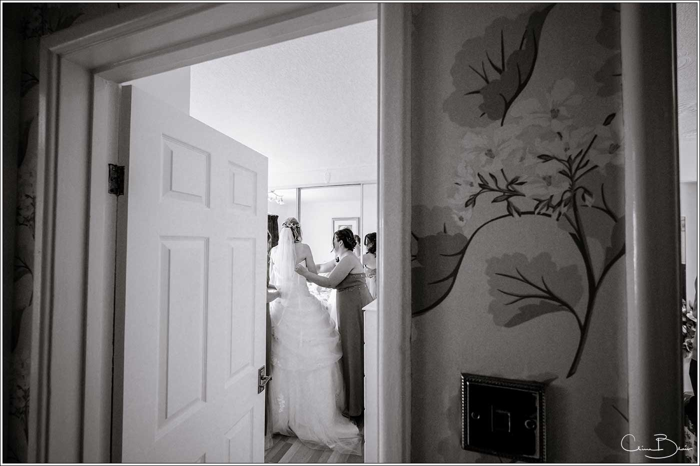 Bride getting ready-by Hampton manor wedding photographer Clive Blair Photography