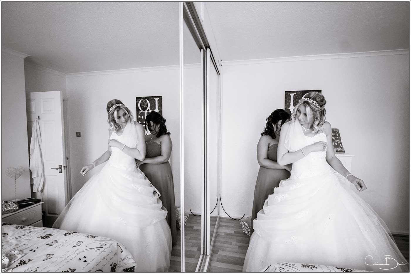 Bride in reflection-by Hampton manor wedding photographer Clive Blair Photography