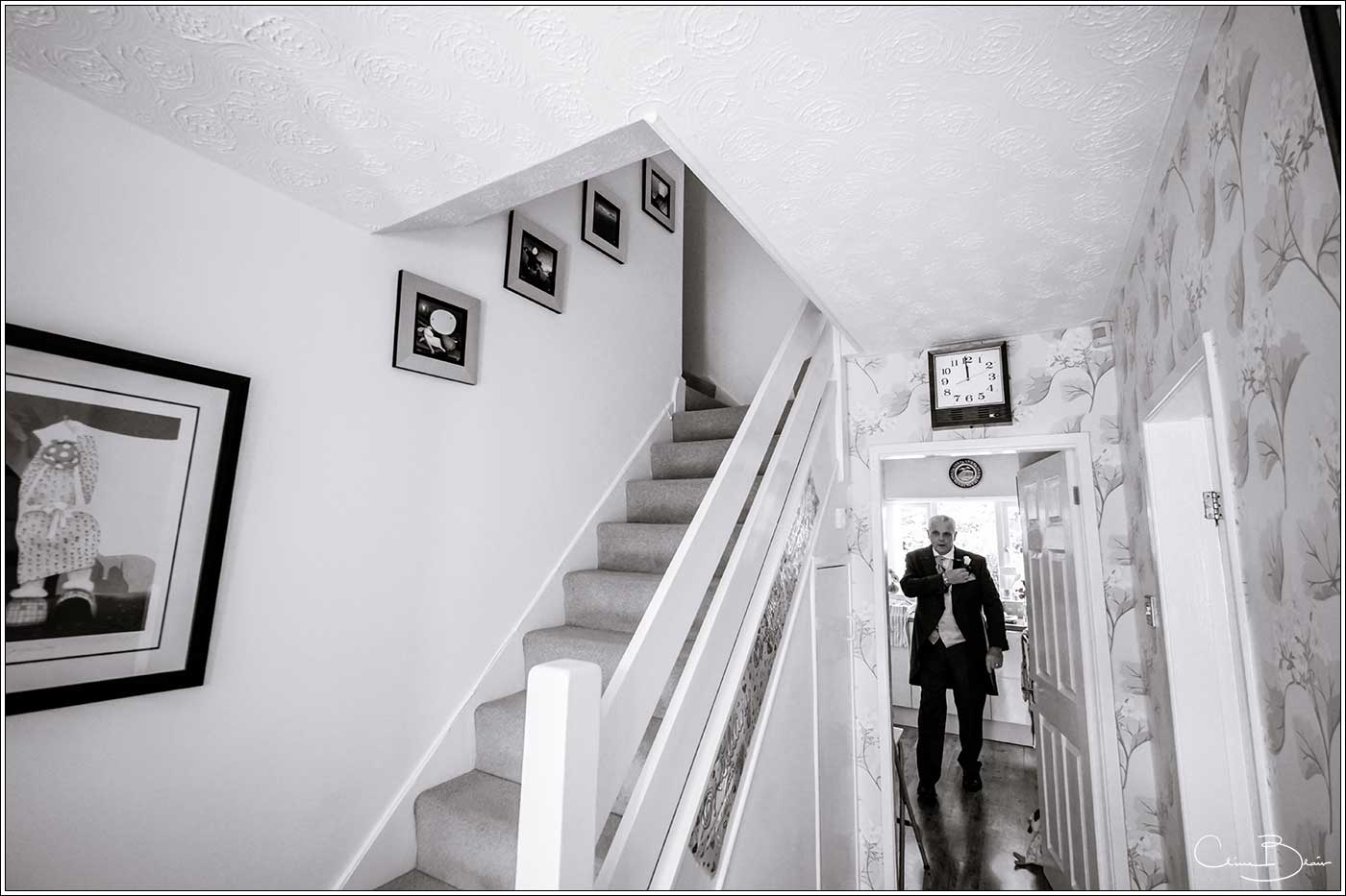 father of bride waiting to see his daughter-by Hampton manor wedding photographer Clive Blair Photography