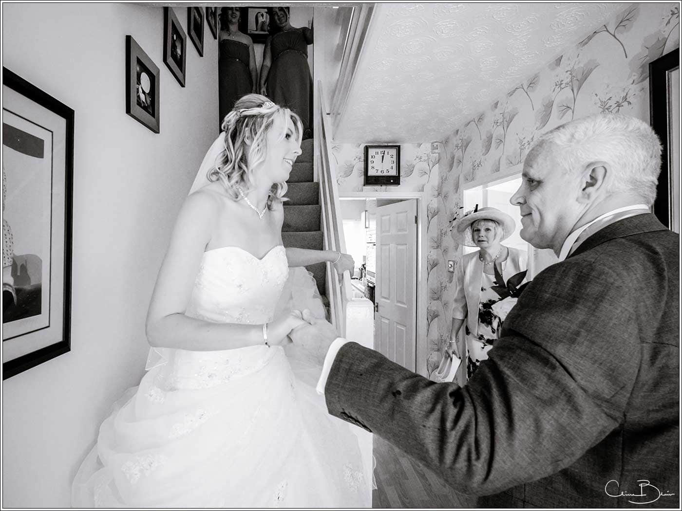 Father of bride seeing his daughter for the first time-by Hampton manor wedding photographer Clive Blair Photography