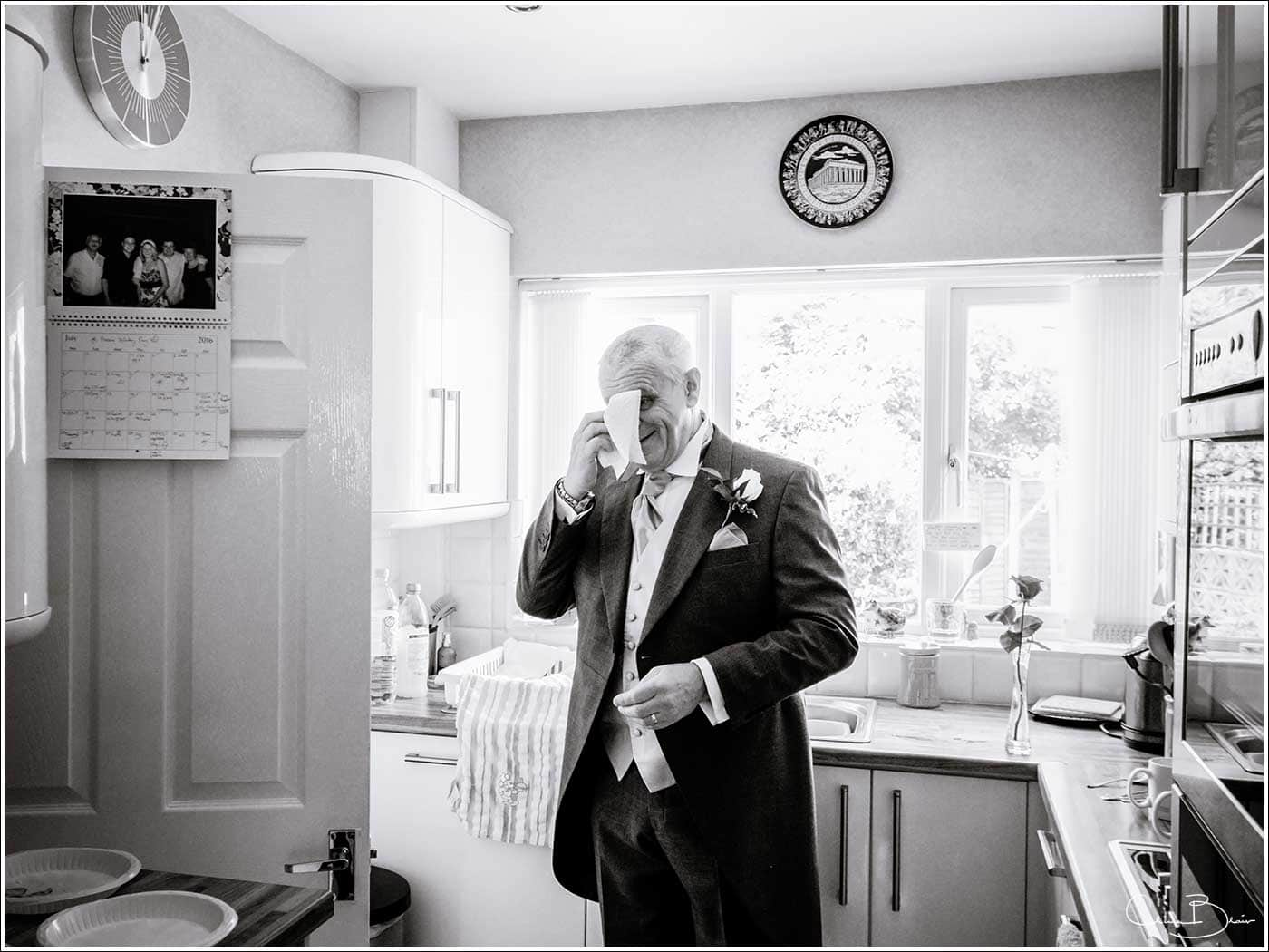 Father of bride wiping away a tear-by Hampton manor wedding photographer Clive Blair Photography