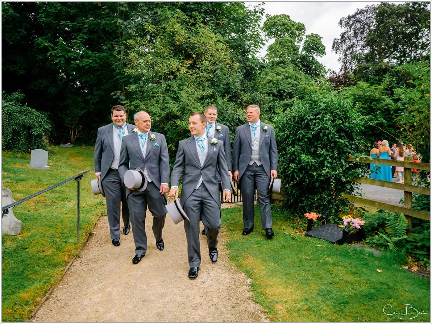 Men arriving at church-by Hampton manor wedding photographer Clive Blair Photography