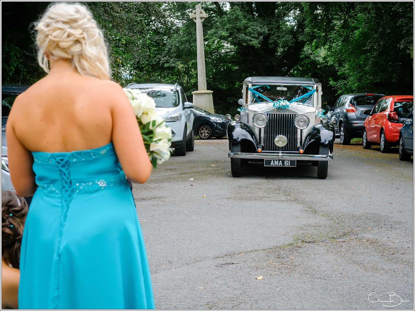 Bridal car arriving-by Hampton manor wedding photographer Clive Blair Photography