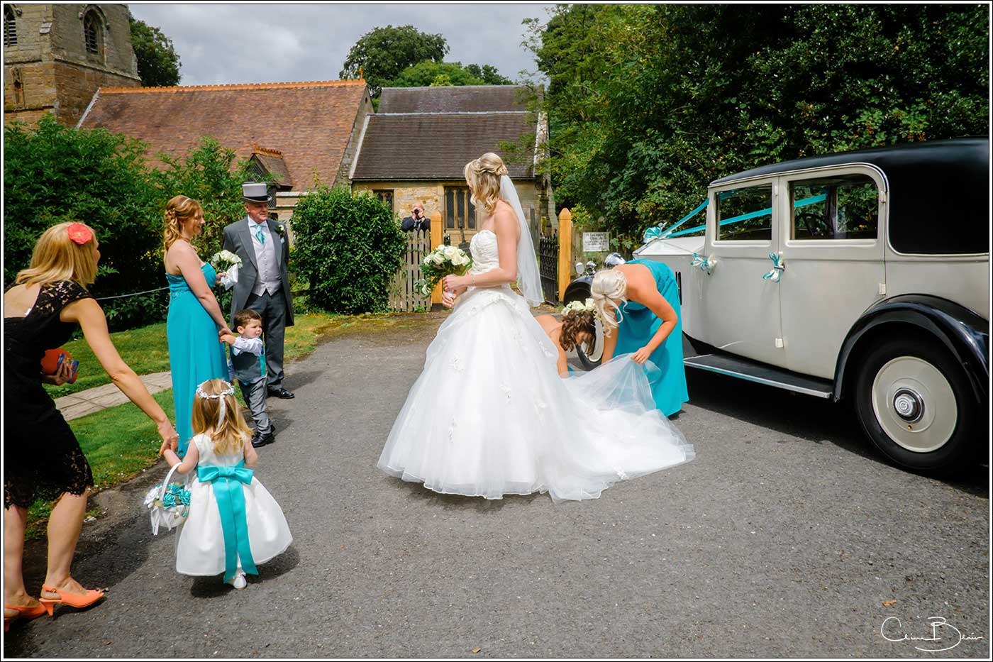 Bride getting out of car-by Hampton manor wedding photographer Clive Blair Photography