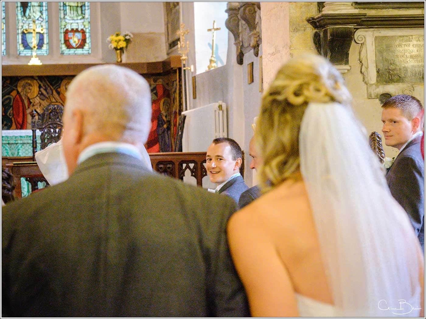 Groom seeing bride for the first time-by Hampton manor wedding photographer Clive Blair Photography