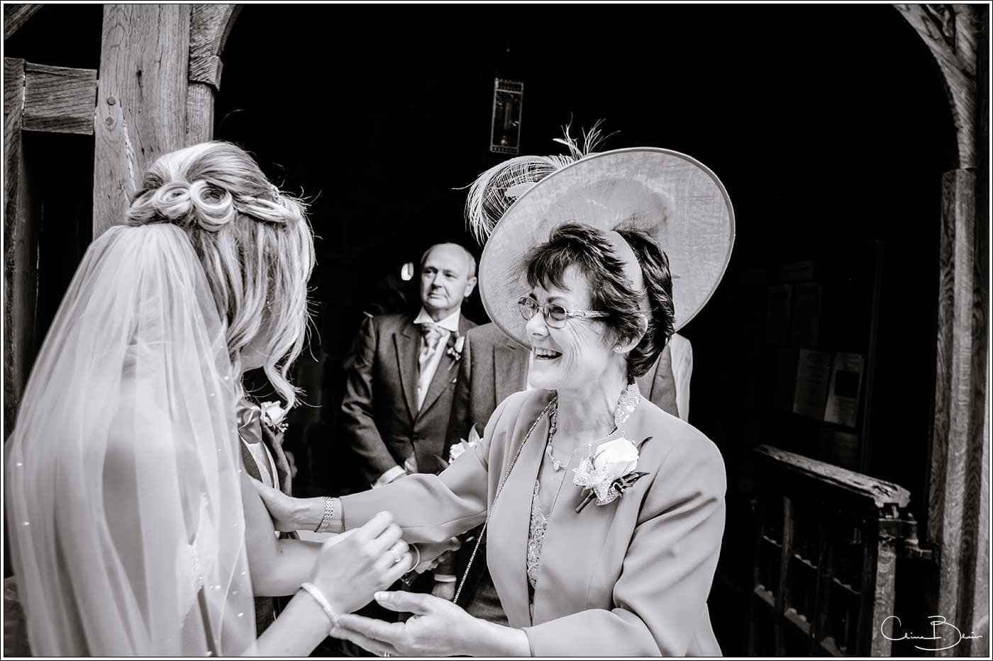 Bride greeted by wedding guest-by Hampton manor wedding photographer Clive Blair Photography