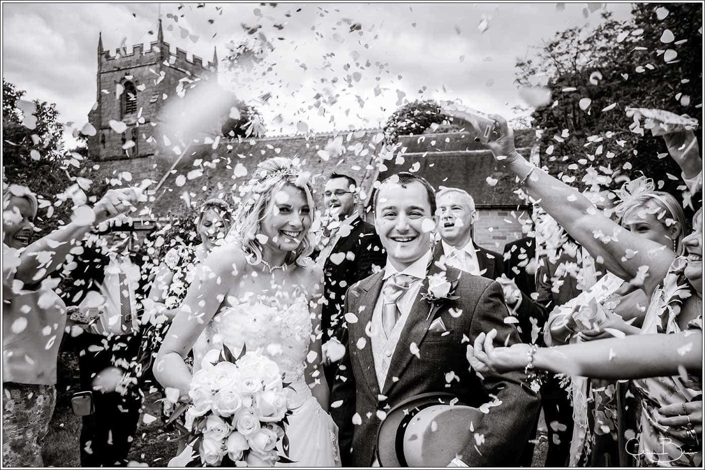 Confetti-by Hampton manor wedding photographer Clive Blair Photography