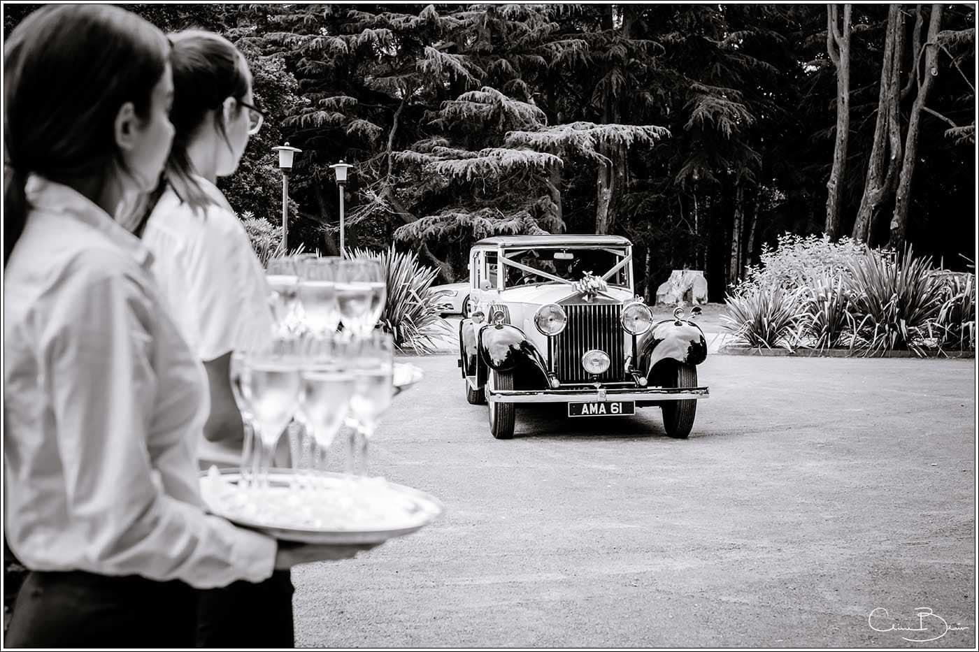Bridal car arriving at Hampton Manor-by Hampton manor wedding photographer Clive Blair Photography