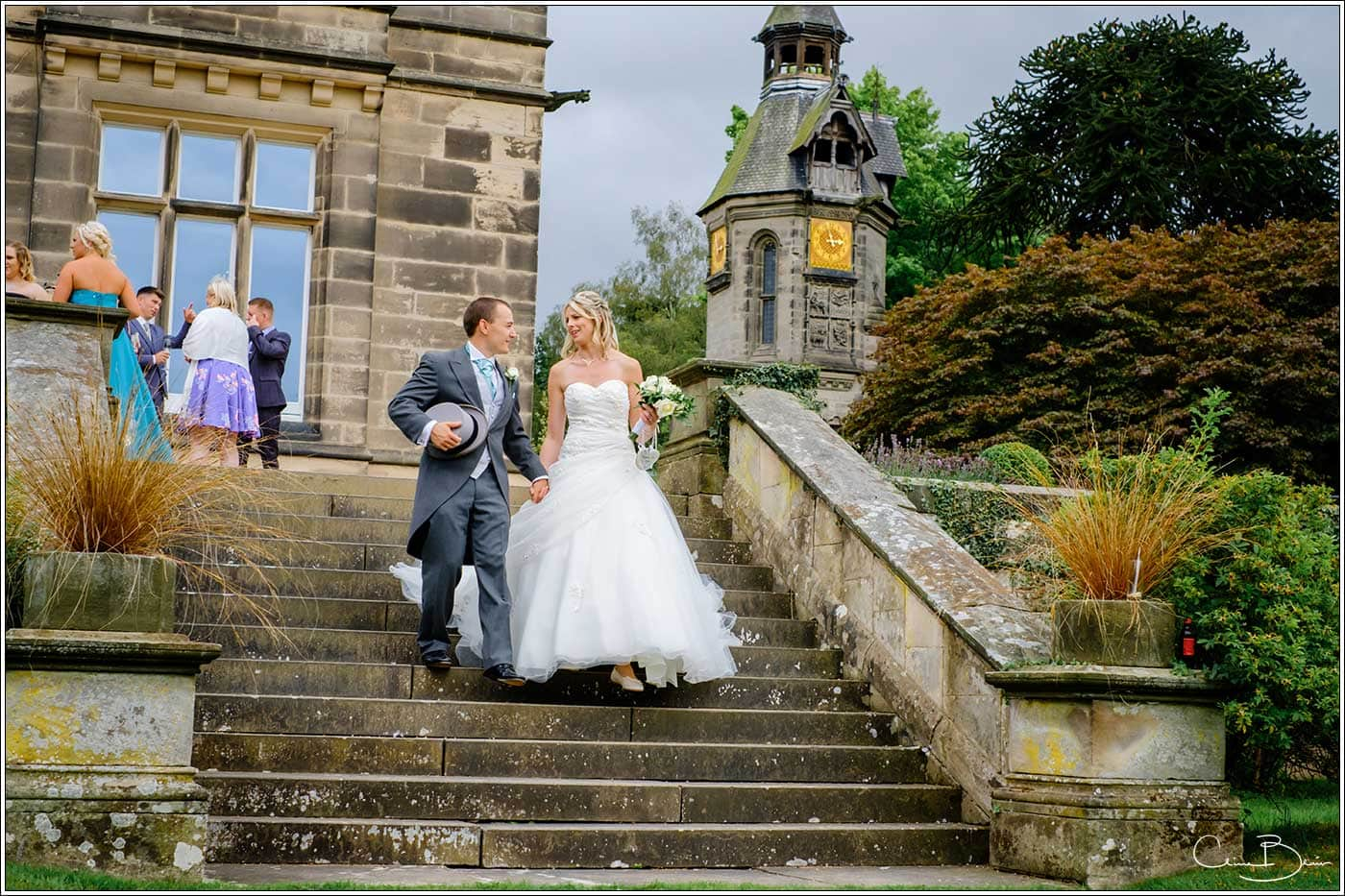 Bride and groom going for a walk in the grounds of Hampton Manor-by Hampton manor wedding photographer Clive Blair Photography