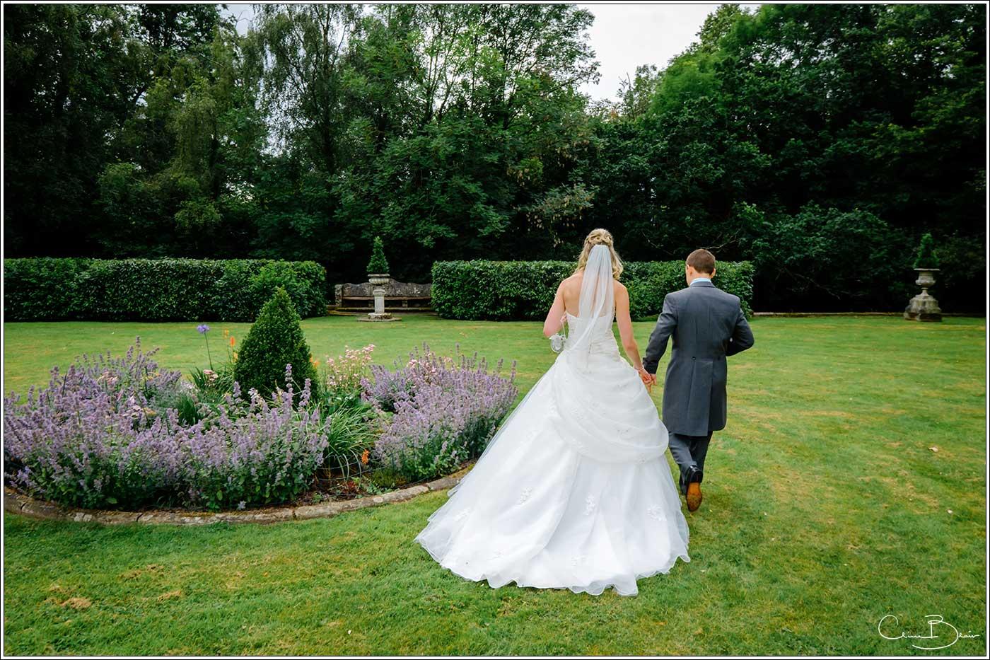 Bride and groom in Hampton Manor garden-by Hampton manor wedding photographer Clive Blair Photography