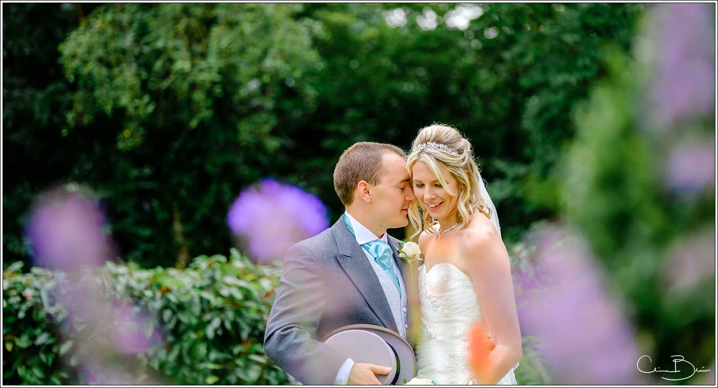 Bride and groom alone in the garden of Hampton Manor-by Hampton Manor wedding photographer Clive Blair Photography