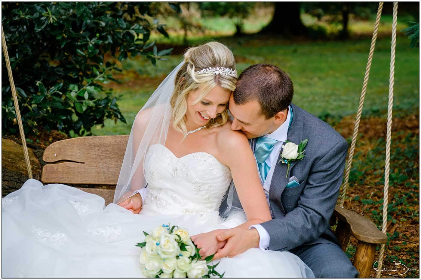 Bride and gfroom on the Hampton Manor swing -by Hampton manor wedding photographer Clive Blair Photography