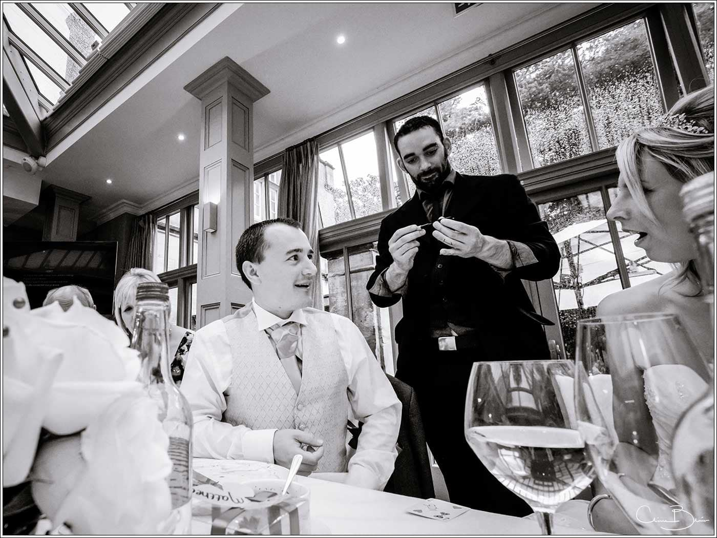 Jester Styles working the tables at a wedding-by Hampton manor wedding photographer Clive Blair Photography