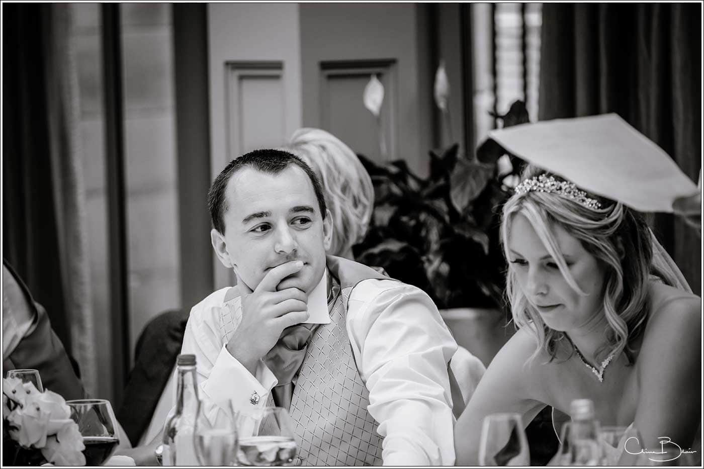 Groom looking at bride during the speeches-by Hampton manor wedding photographer Clive Blair Photography