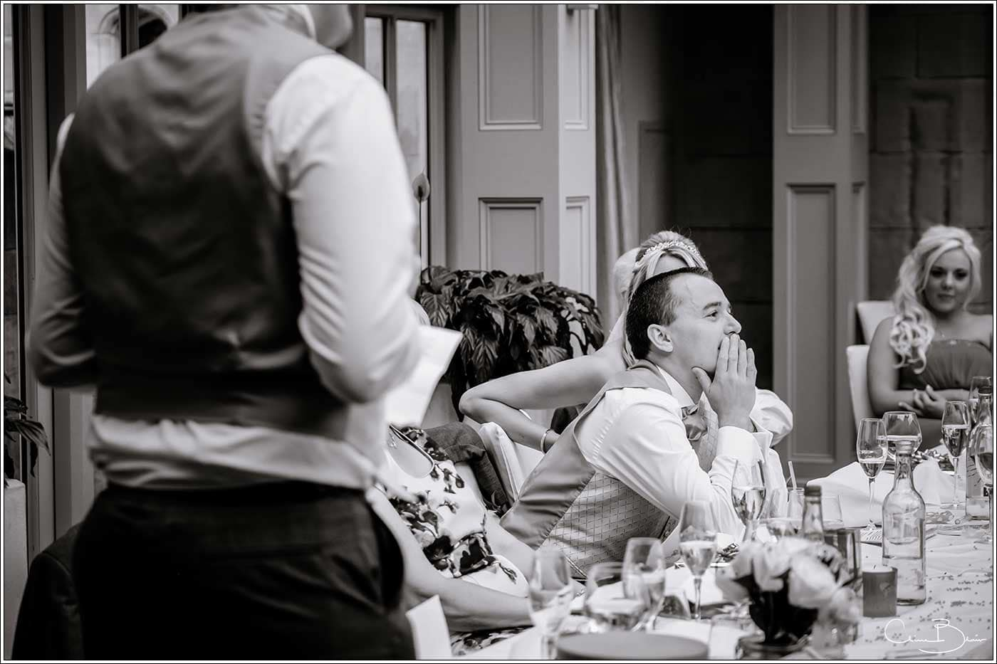 Embarrassed groom during the speeches-by Hampton manor wedding photographer Clive Blair Photography