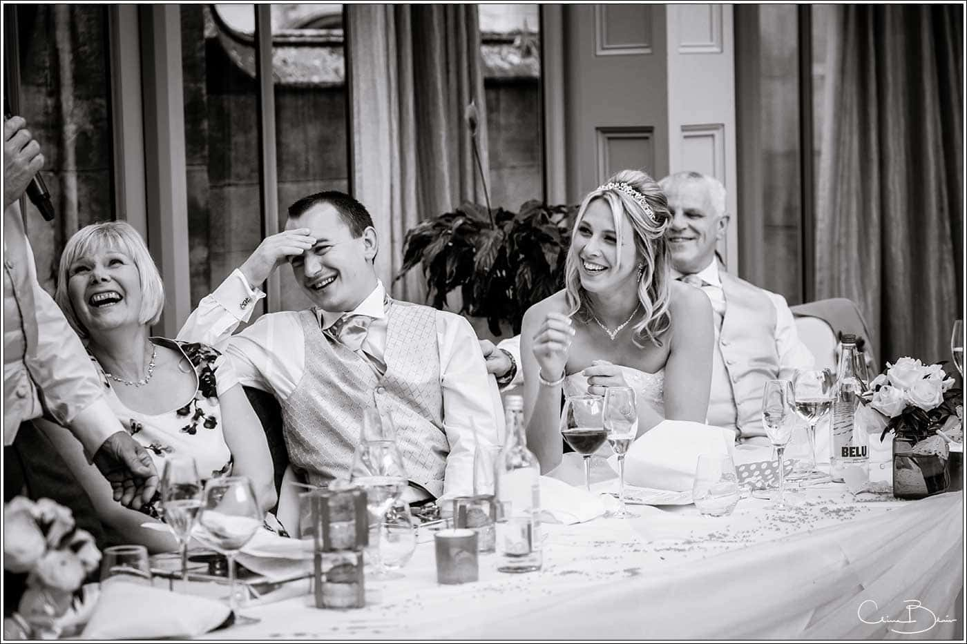 Groom embarrassed during the speeches-by Hampton manor wedding photographer Clive Blair Photography