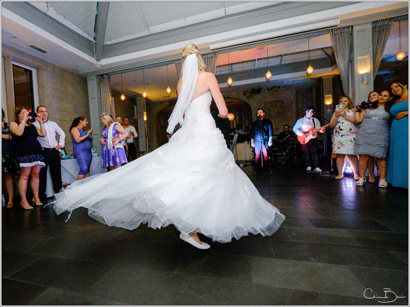 Bridal twirl during the first dance-by Hampton manor wedding photographer Clive Blair Photography
