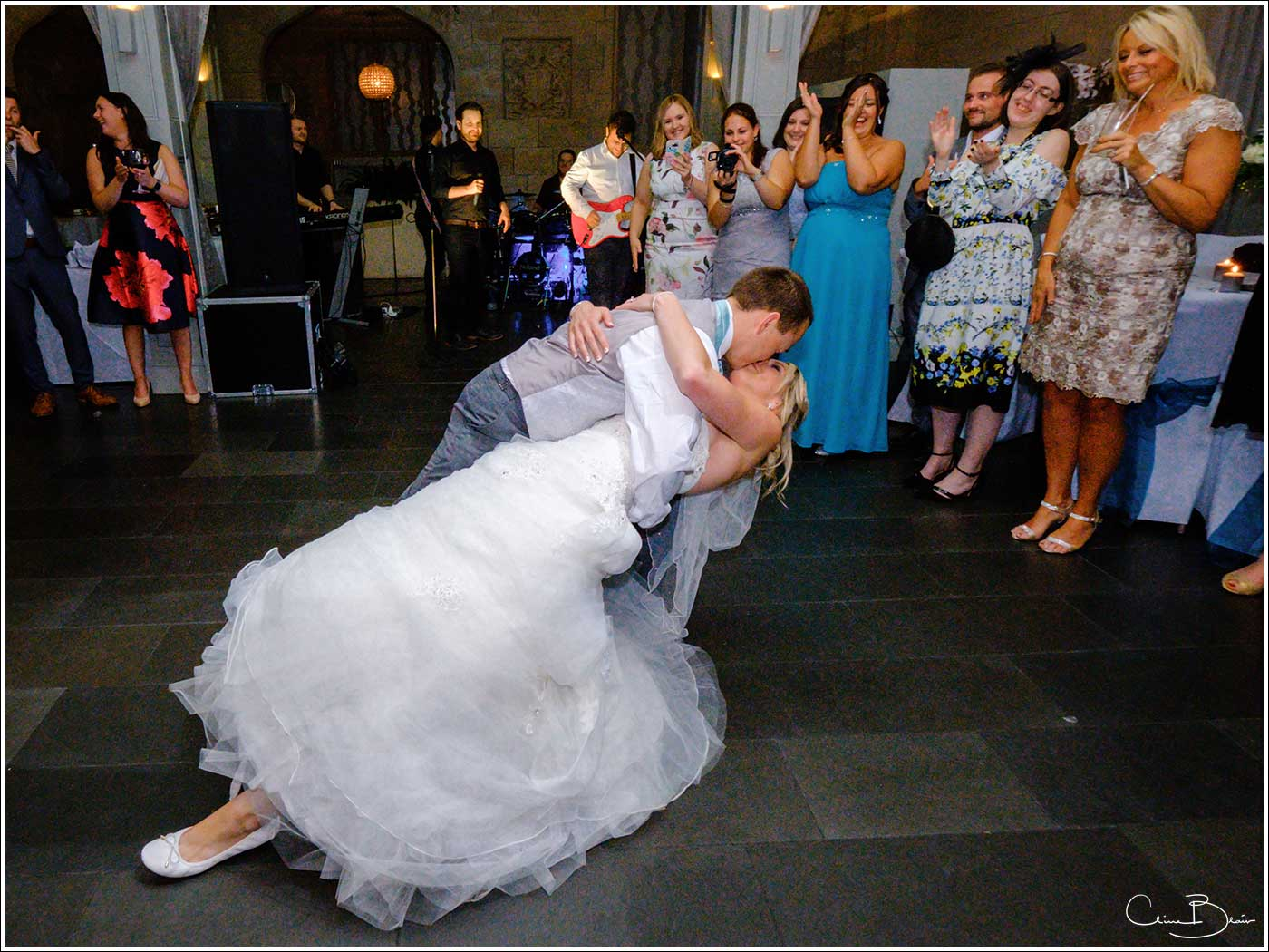 Groom dipping his bride at the end of their first dance-by Hampton manor wedding photographer Clive Blair Photography