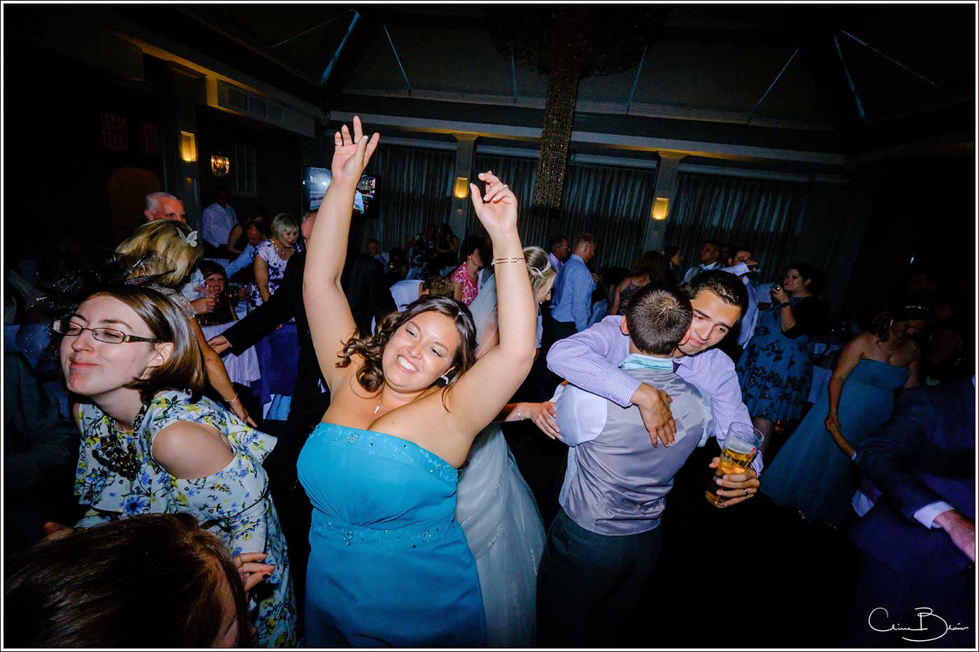 Woman dancing during eveing reception-by Hampton manor wedding photographer Clive Blair Photography