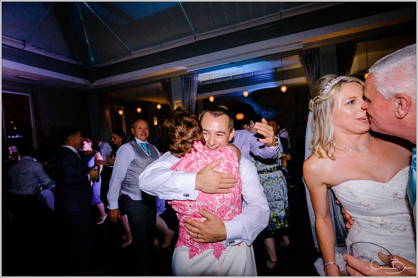 Groom hugging his mother-by Hampton manor wedding photographer Clive Blair Photography