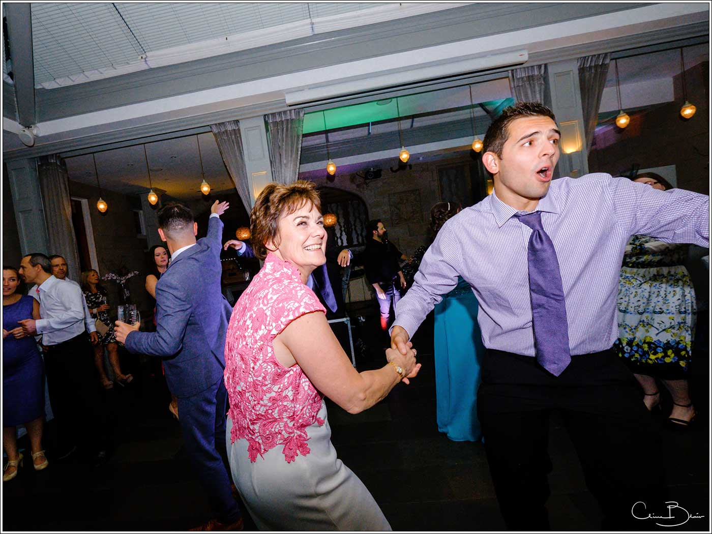 Groom's mother on dance floor-by Hampton manor wedding photographer Clive Blair Photography