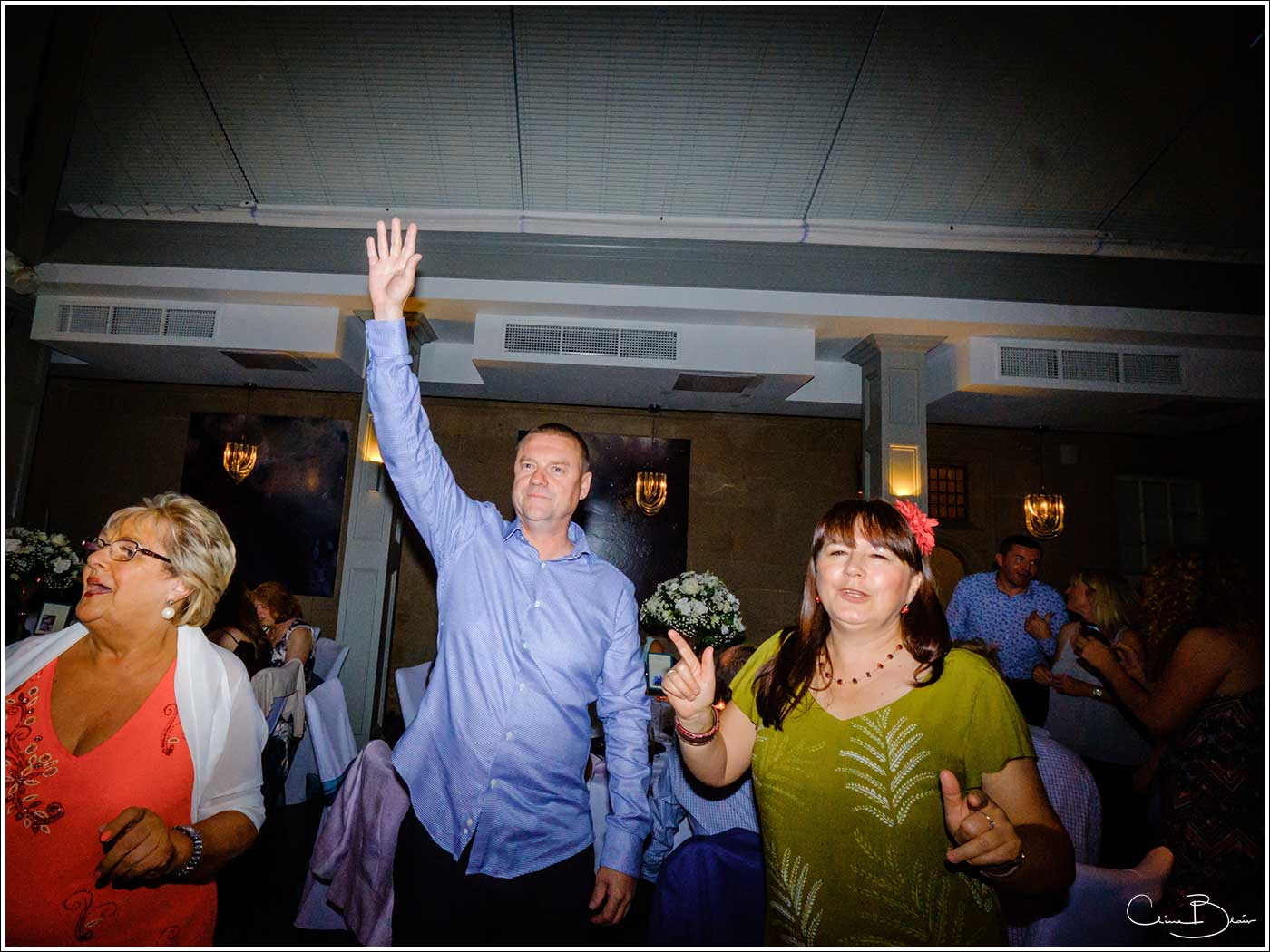 three guests on the dance floor-by Hampton manor wedding photographer Clive Blair Photography